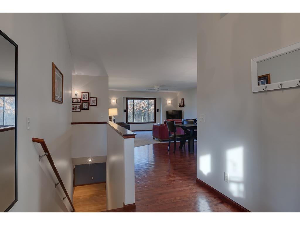 Stepping into the home you'll notice the stunning hardwood floors flow throughout to the dining/kitchen area.