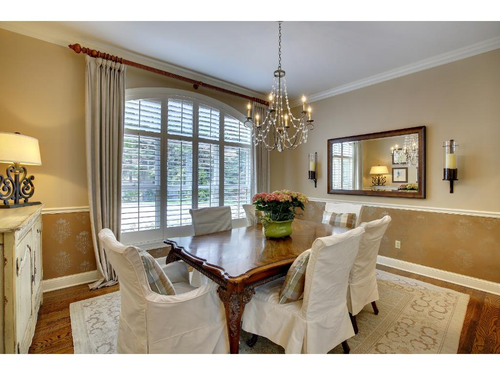 The Dining Room is a perfect gathering space for Sunday night dinners or grand celebrations. Detailed with crown molding, a chair rail, custom painting, hardwood floors and gorgeous views.