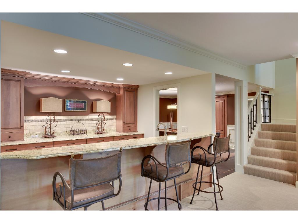The Lower Level Wet Bar features Granite counters, tiled floors and back splash, Drawer Fridge & Freezer and Asko Dishwasher.