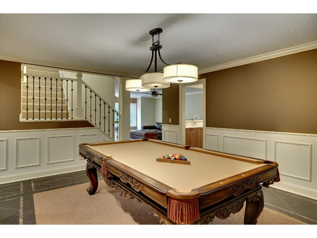 Enameled wainscoting and custom built-ins offer a relaxing space for your billiard table.
