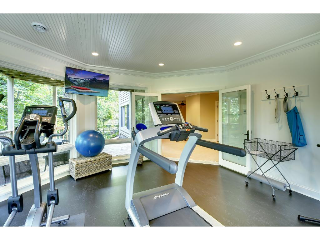 This room will make you want to work out! Five floor to ceiling windows bring in nature and Marmoleum floors have in-floor heat - just perfect for Bikram Yoga.