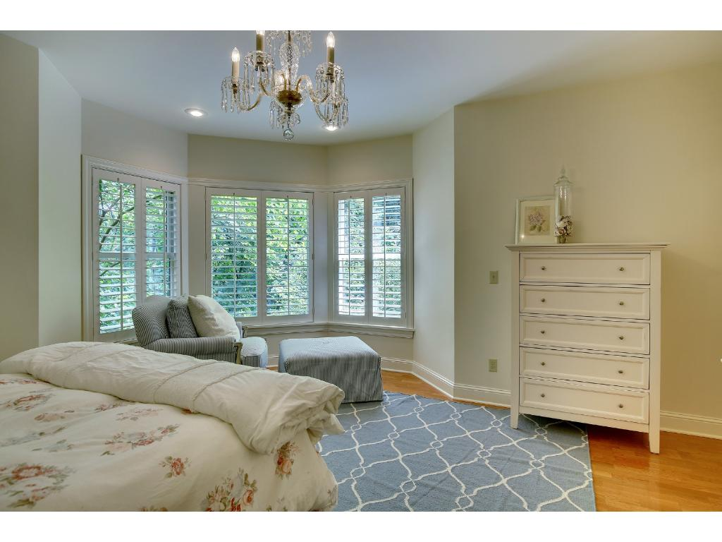 This lower level bedroom can be a second master suite and features a large walk-in closet and bay window with private, treetop views.