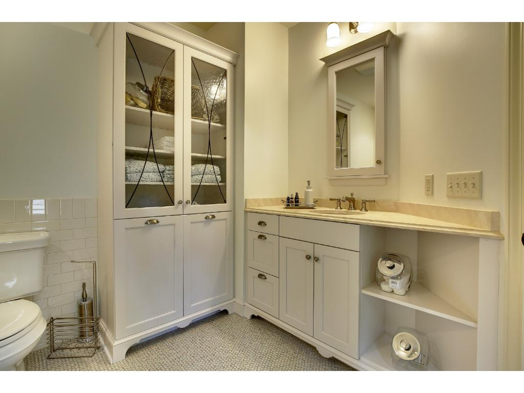 The private, en suite bath in the lower level bedroom is a peaceful space with fresh updates.