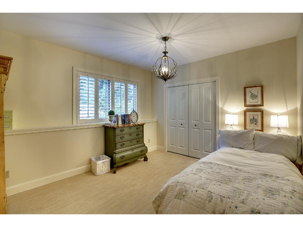 There are two additional Junior Bedrooms located on the lower level which share an updated 3/4 bathroom.