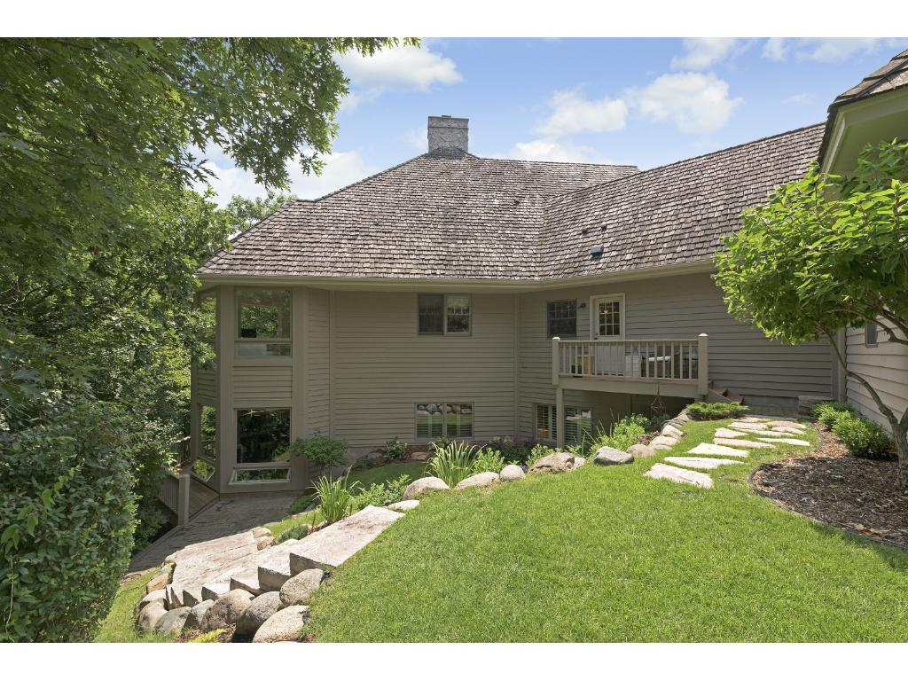This is a very private setting, backing to the Purgatory Creek Conservation Area and surrounded by mature trees. In the spring, the owners can hear Purgatory Creek bubbling through the backyard.