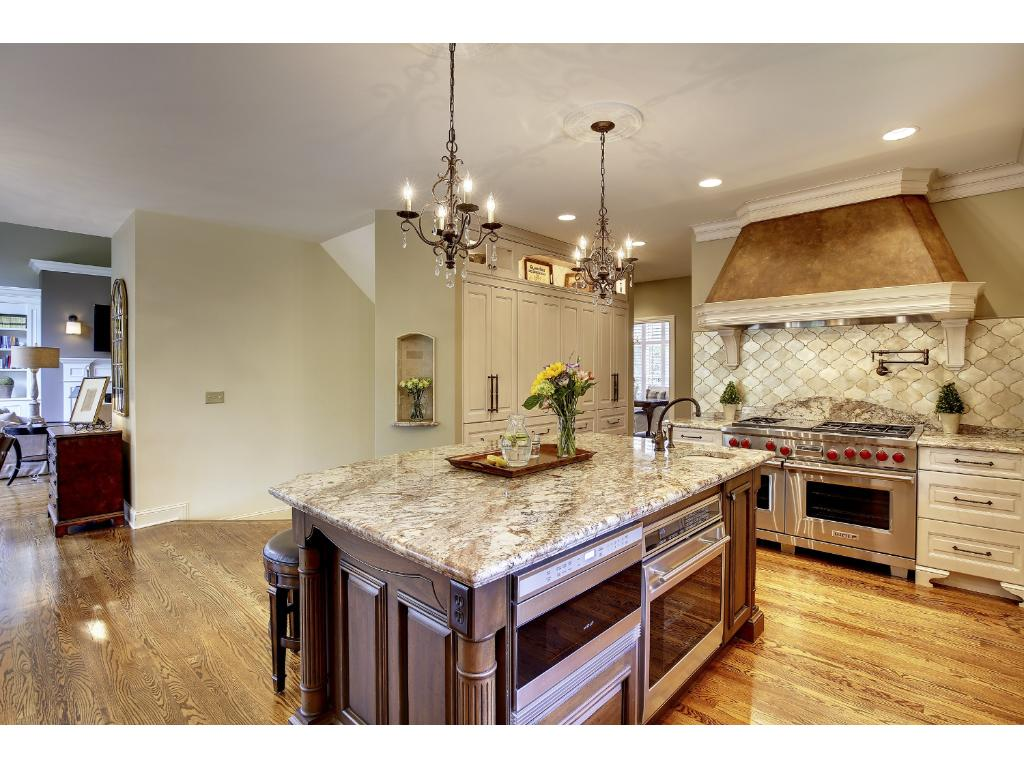 This well equipped Kitchen features a 6 burner Wolf range with 2 ovens & BEST range hood, and a 3rd Wolf Oven and Wolf Microwave in the island. There is a commercial-sized Subzero Fridge & Freezer & large wall pantry with roll-out shelves.