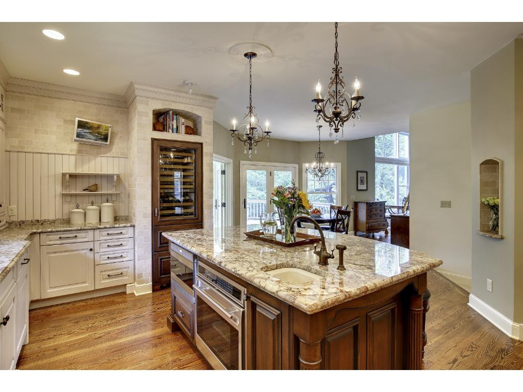 Gorgeous custom cabinetry, Granite counters with beveled edges, two Asko Dishwashers, built-in wine cabinet and fridge - all makes cooking and entertaining a breeze.