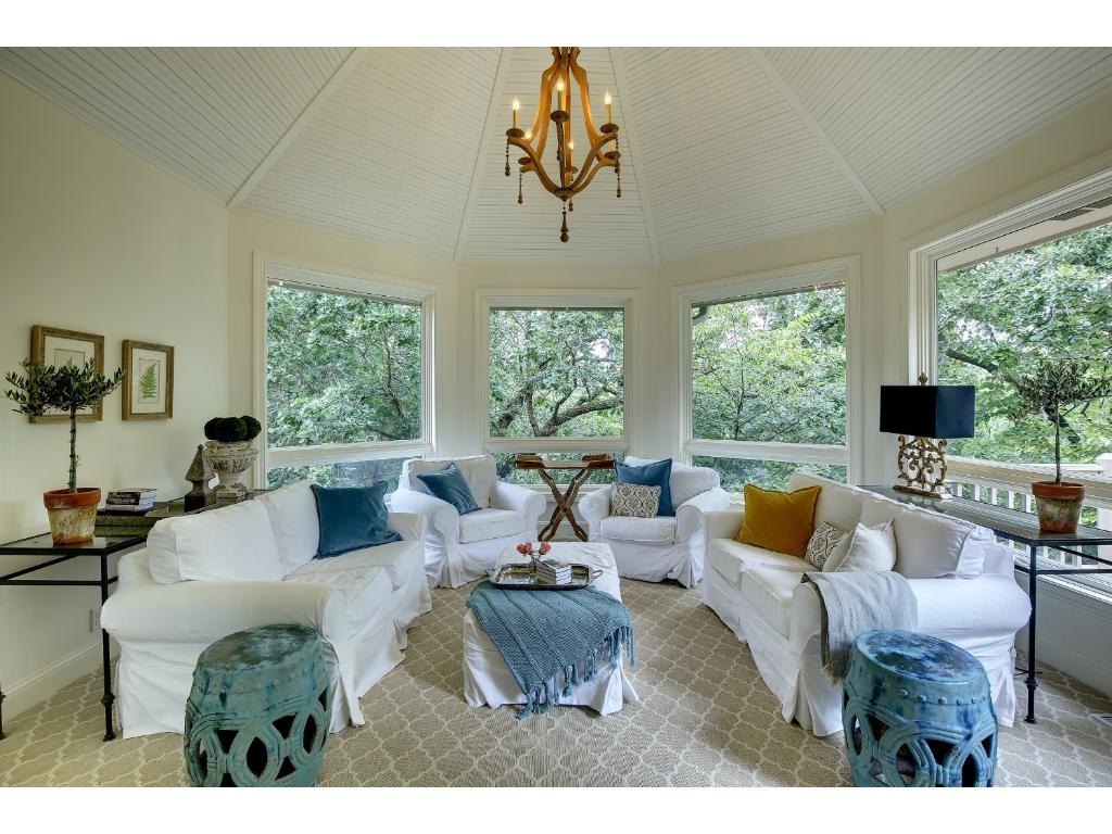 French doors open to this beautiful Sun Room, freshly remodeled in 2015 with a vaulted bead-board ceiling, new carpet, paint and five picture windows