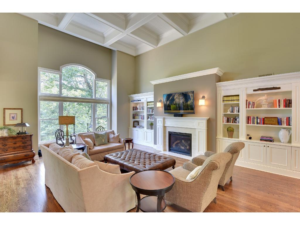 This is a true Great Room with 18 foot box-beam ceilings with bead board & crown molding. The Gas Fireplace is flanked with a crema limestone surround and picture windows showcase the tree-top views. Wired for surround sound.