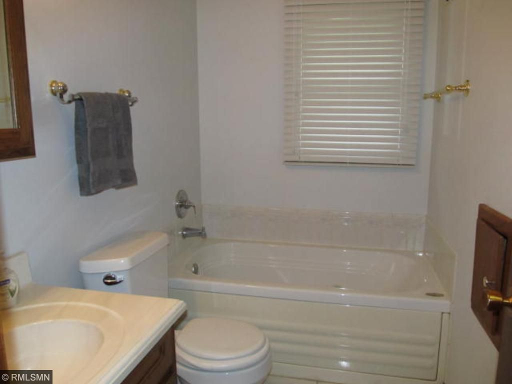 Main floor full bath with Jacuzzi tub has been recently updated.