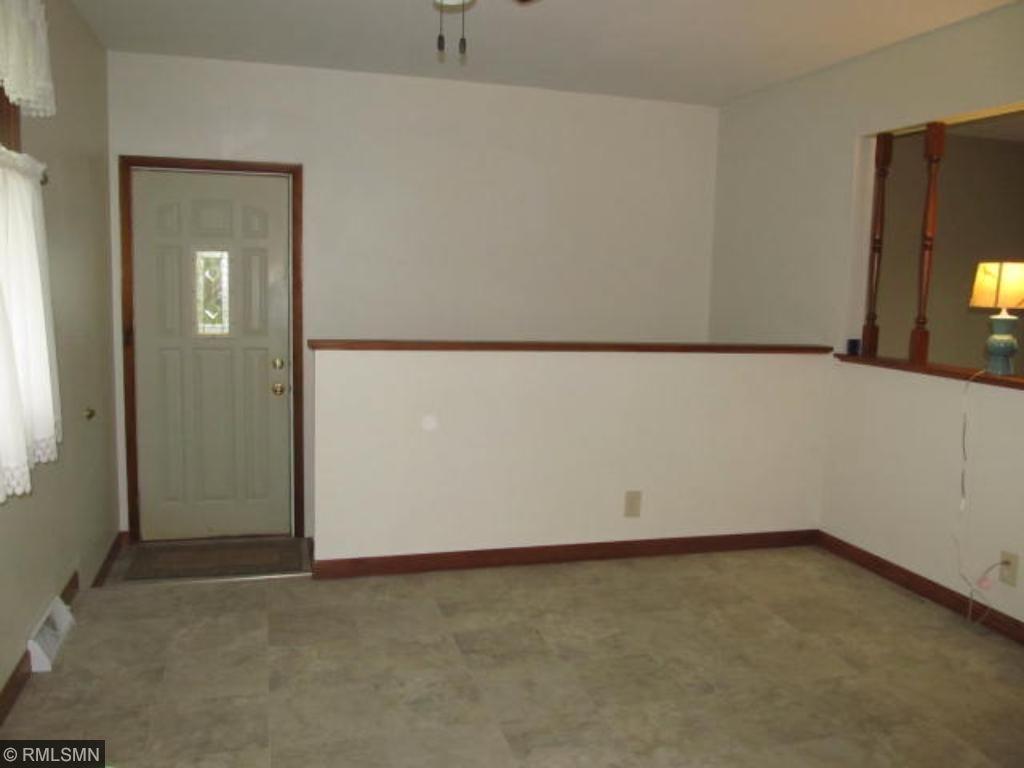 Dining room with door to backyard.