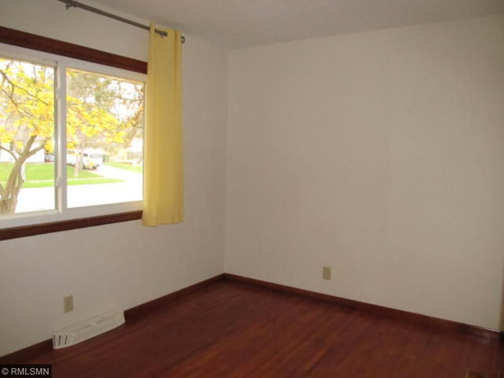 2nd bedroom with newly refinished hardwood floors.