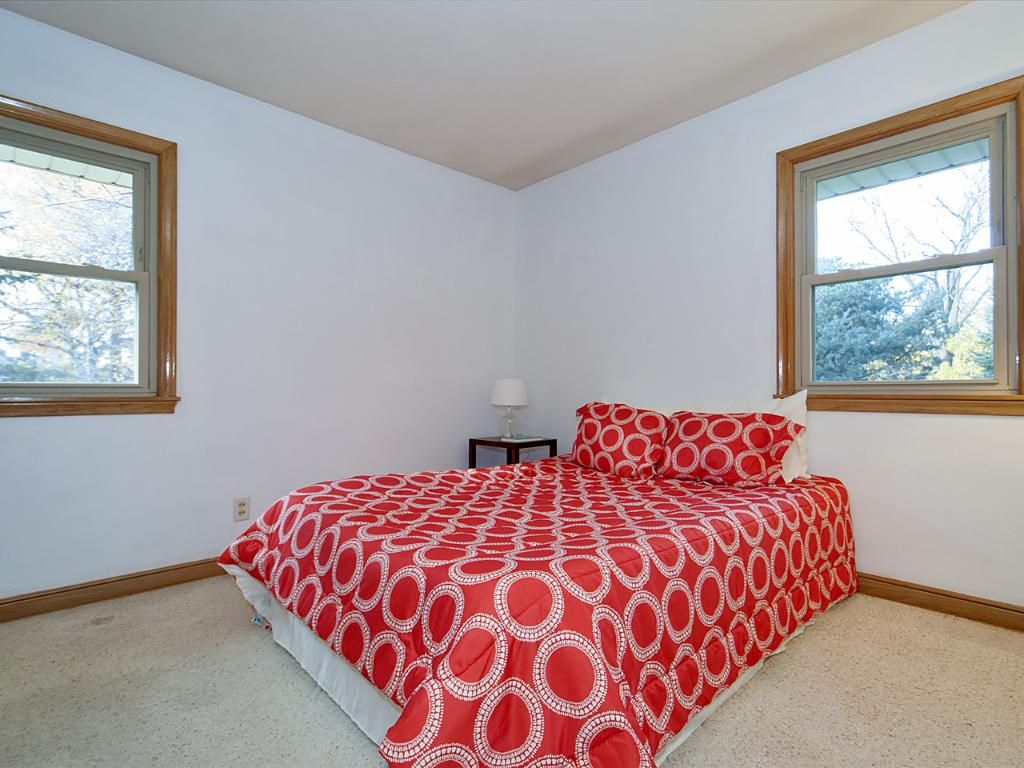 Back facing bedroom with large closet and storage.