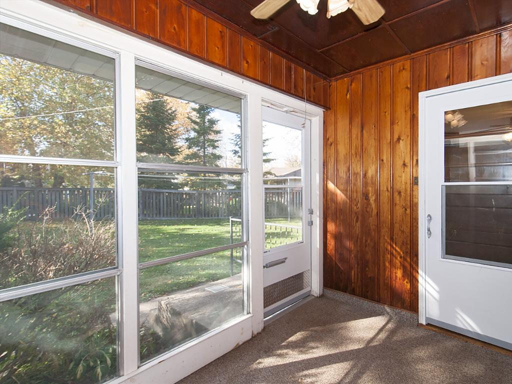Sunroom opens onto peaceful back yard.