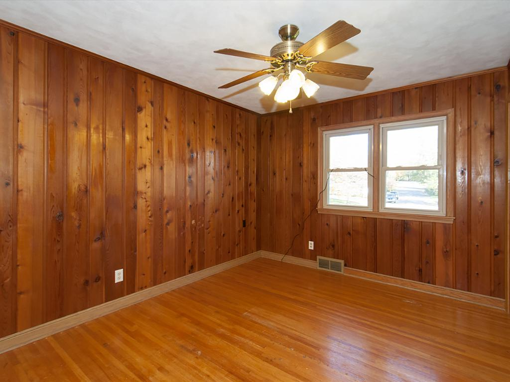 """Front facing bedroom reveals 3/4"""" oak hardwood floors that are throughout the main floor of the home."""