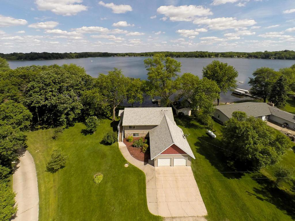 206' of Private Level Lakefront on Ida Lake with almost 1 Acre lot on private cul-de-sac!
