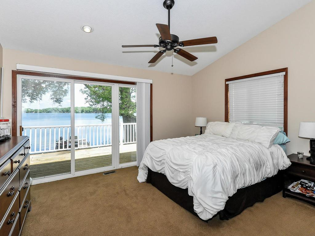 Large Master Suite Walks Out to Deck. Huge Walk In Closet. Vaulted Ceiling for a nice airy feeling.