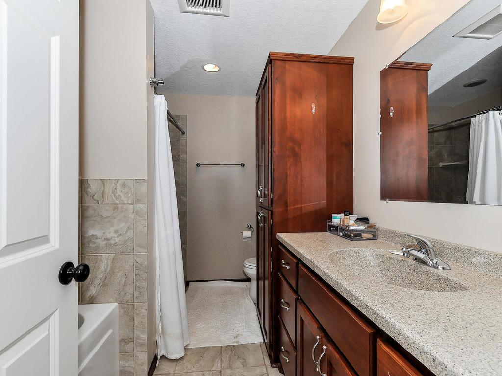 Master Bath has Separate tub/Shower, Cherry Cabinets and Tile Floor and Tile Surround!