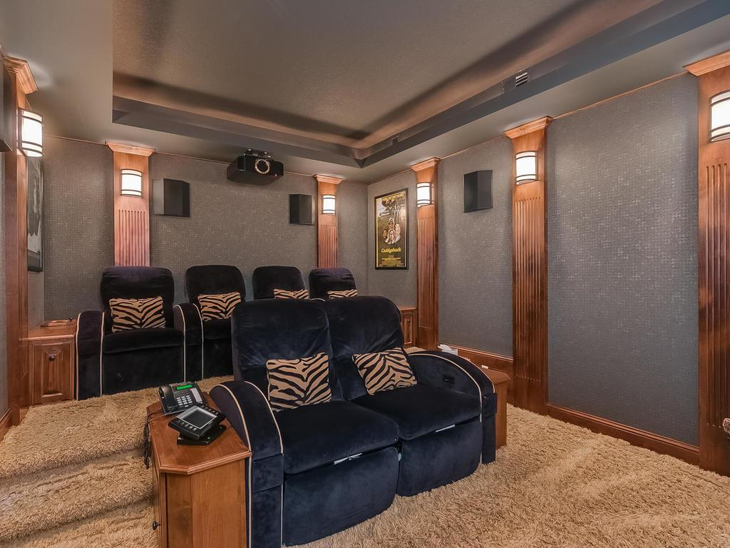 Enjoy movies in the sound-proof at-home theater. There is quality throughout with high-end finishes, incredible craftsmanship and meticulous owners.