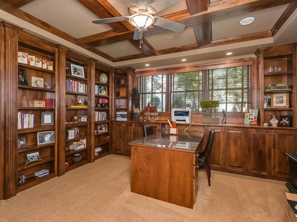 Classic office/study with wood beam ceiling, bookshelves and built-ins.