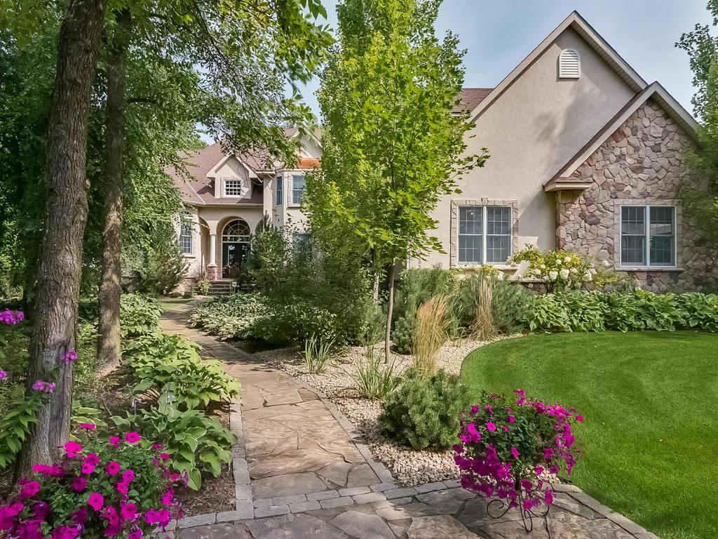 Grand front entry to this stately home nestled back on a 3.1 private wooded acre lot.