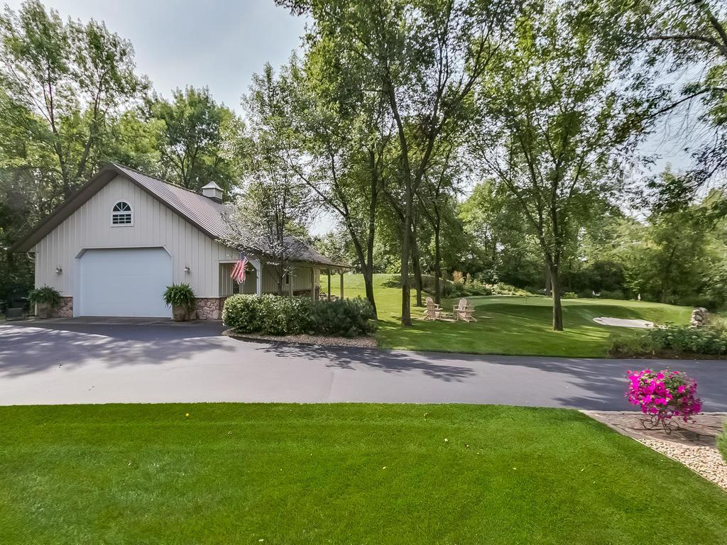 Amazing 43'x28' insulated and heated additional 4 car garage outbuilding/workshop with covered side patio overlooking the putting green and fire-pit.