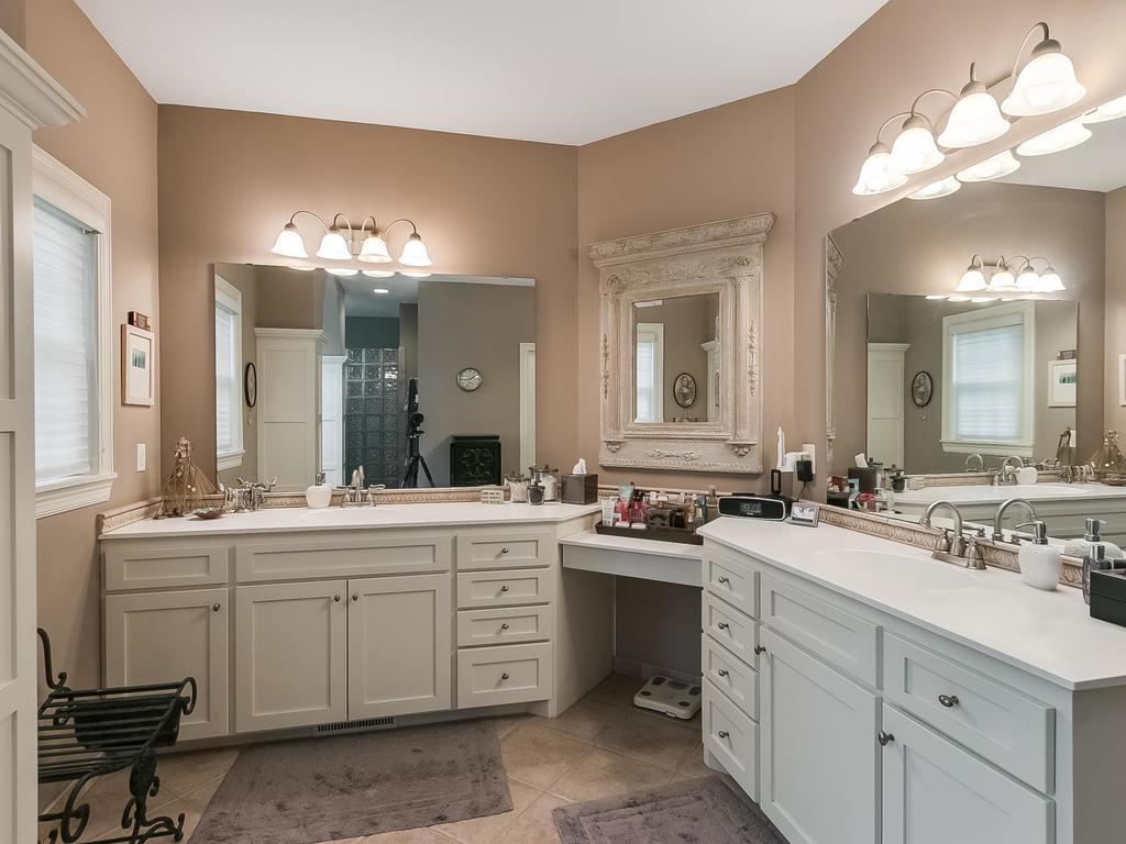 Owner's bath with double vanity, separate tub and walk-in tile-surround shower.