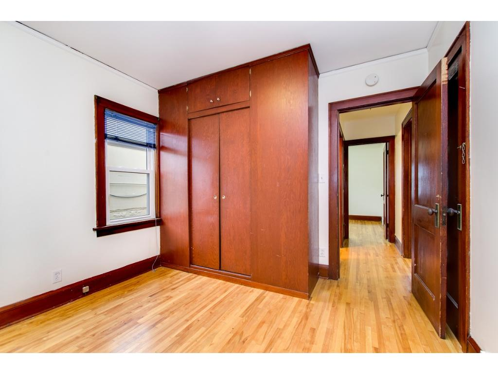 NW main floor bedroom with built-in closet and newer windows! 4 bedrooms total!