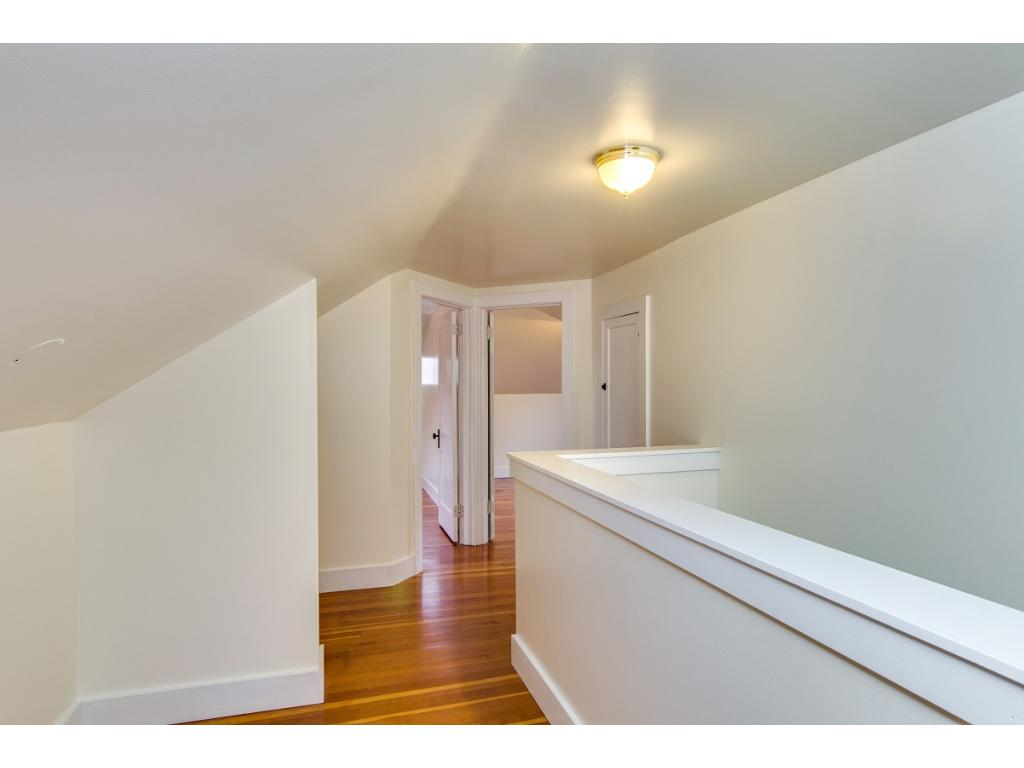 Freshly painted upstairs with more of the beautiful hardwood floors and two nicely-sized 2nd floor bedrooms!
