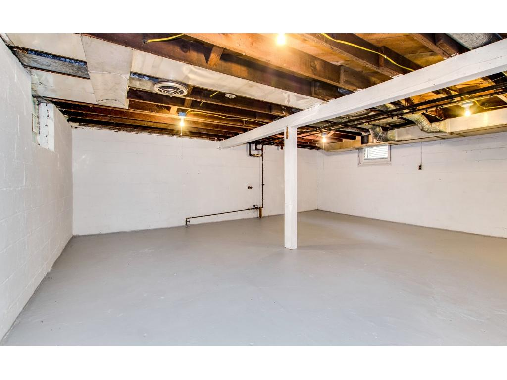 Clean unfinished basement with nice ceiling height ready to be finished and add more finished sf!
