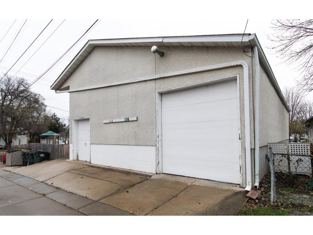 5+ car 2100sf heated garage/shop with alley access! Great opportunity for home business, car enthusiast, landscaping/snow-removal company, etc.