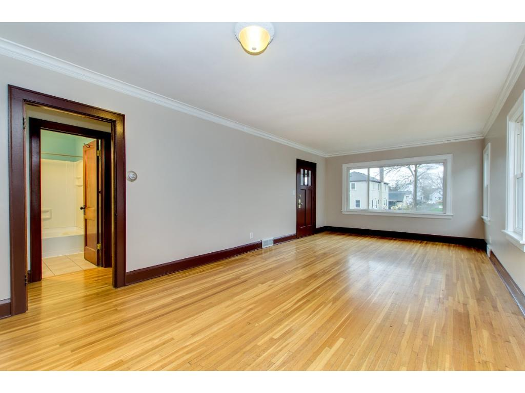 Bright and open living room flows seamlessly to dining room with beautiful hardwood floors throughout! New paint throughout!!!