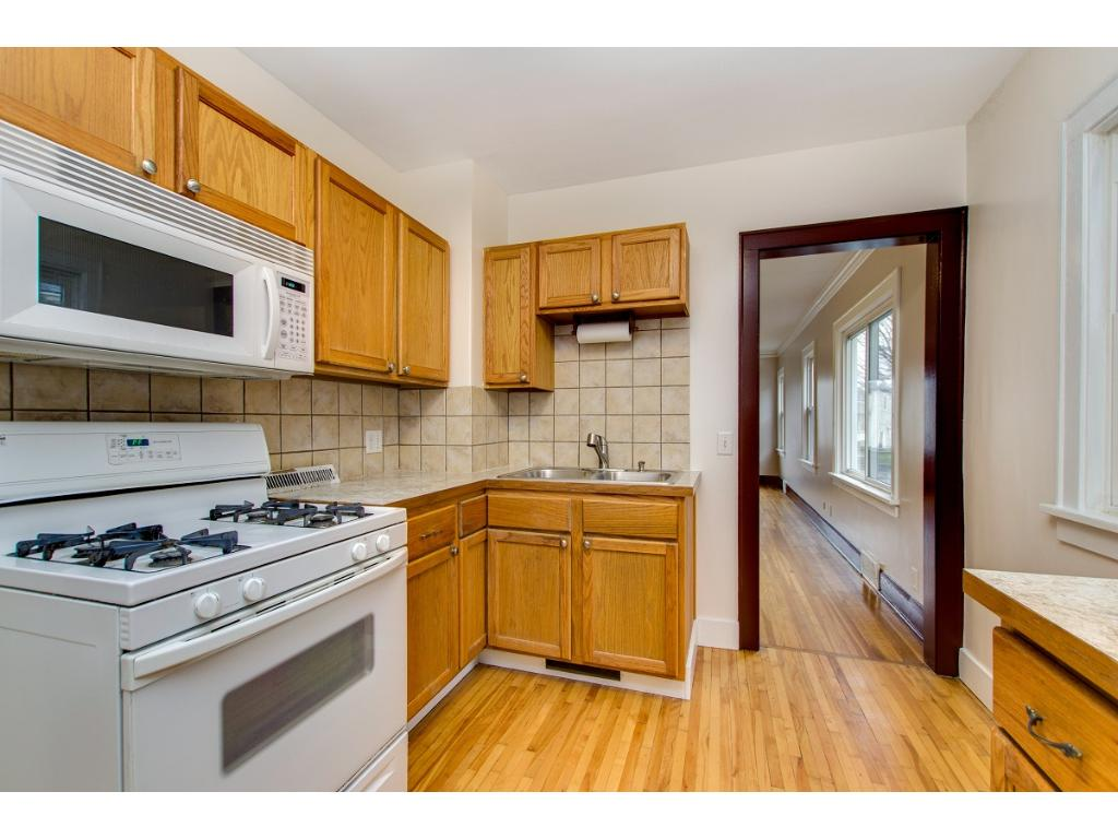 Bright kitchen with some nice updates including new laminate counters and newer cabinets.