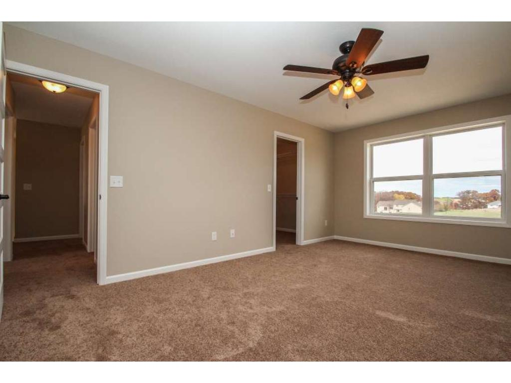 Master Bedroom features large windows, ceiling fan and large Walk-in Closet