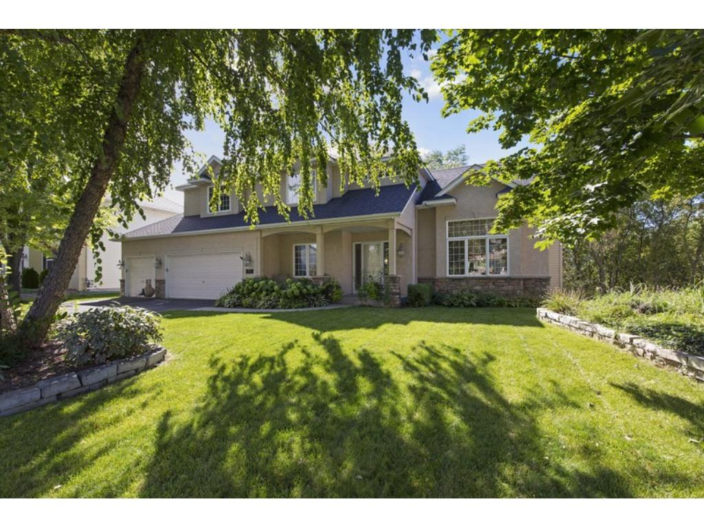 Exceptional Two Story home, located on a premier lot, offering nature views from 3 levels!  Unbeatable!