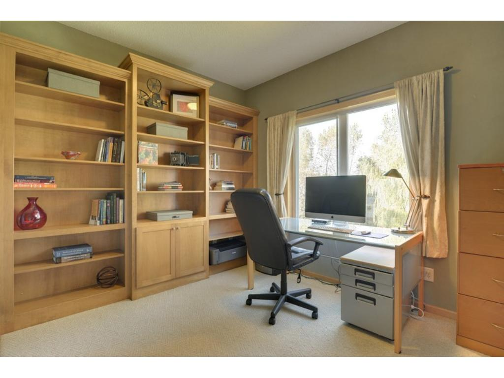 The main level also offers an office with a wall of built-ins, also with great views!  Enjoy office work!  Main level laundry room as well
