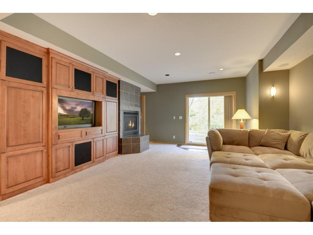 Always desirable walk-out, offers expansive windows, natural light, access & views of your very private yard!