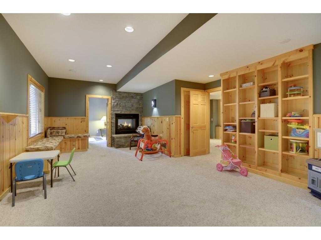 Walls of custom cabinetry & shared Stone fireplace.  SO much to love.  See Supplement for details!
