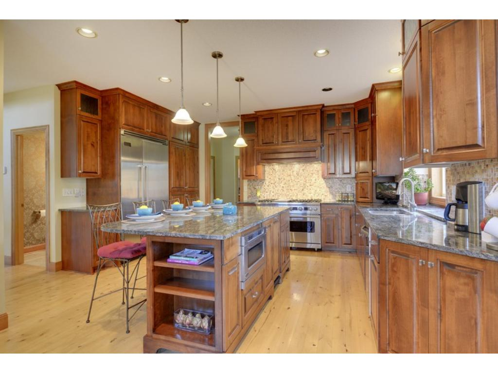 Stunning Chef's kitchen offers custom cabinetry & craftsmanship with spacious, integrated center island with granite, in addition to an informal dining room!