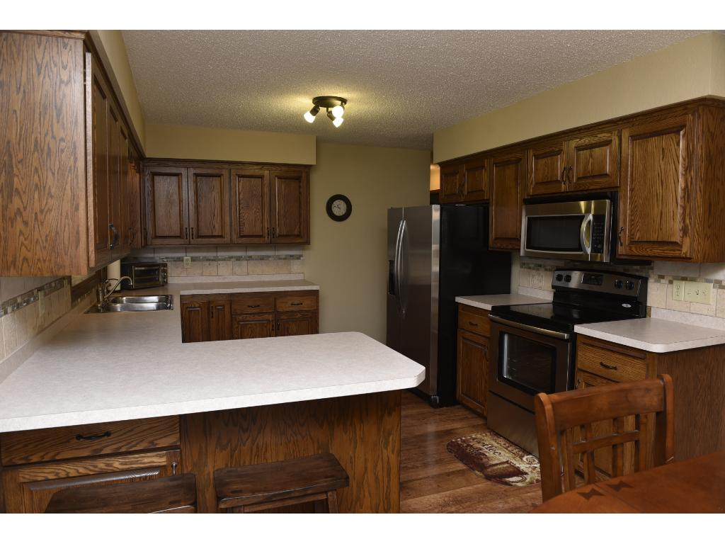 Updated kitchen with beautiful cabinets, all new light fixtures, freshly sprayed ceilings and pretty laminate floors.
