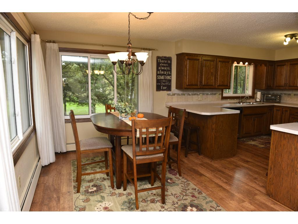 Nice sized dining room is connected to the kitchen and walks right into the living room.  Enjoy the views of your park like yard from the dining room table.