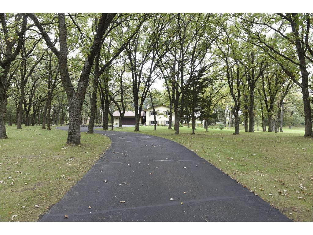 Gorgeous 8.5 acre property with towering White Oaks, beautiful landscaping and a picturesque setting.