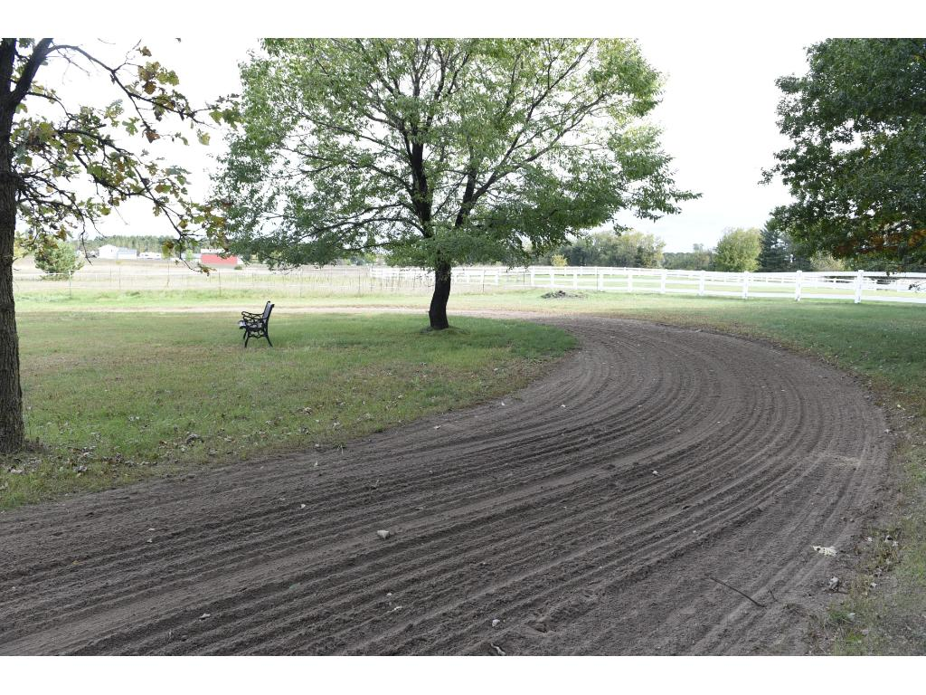 110x195 from fence to fence outdoor riding arena is groomed and well maintained.