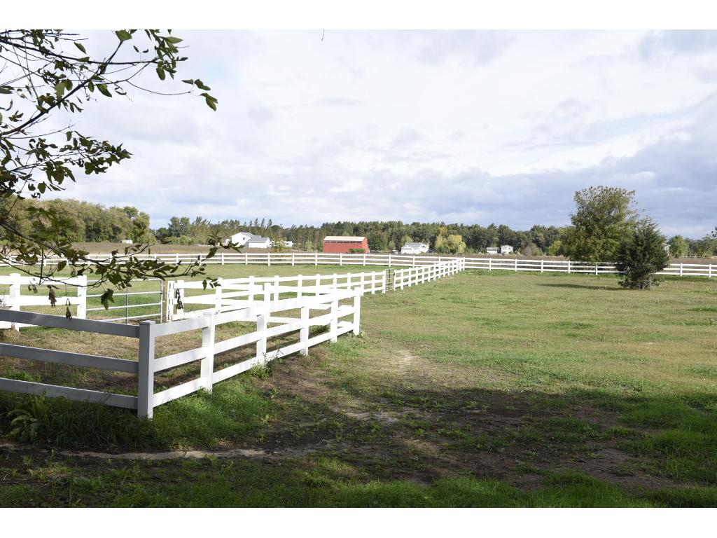 Beautiful vinyl fence along with the electric fence enclose two pasture areas.