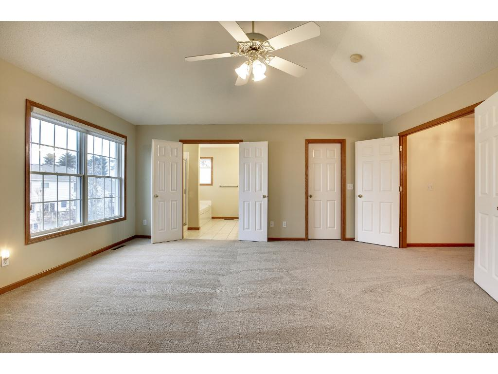 EXPANSIVE owner's bedroom with vaulted ceiling and new carpeting throughout upper level