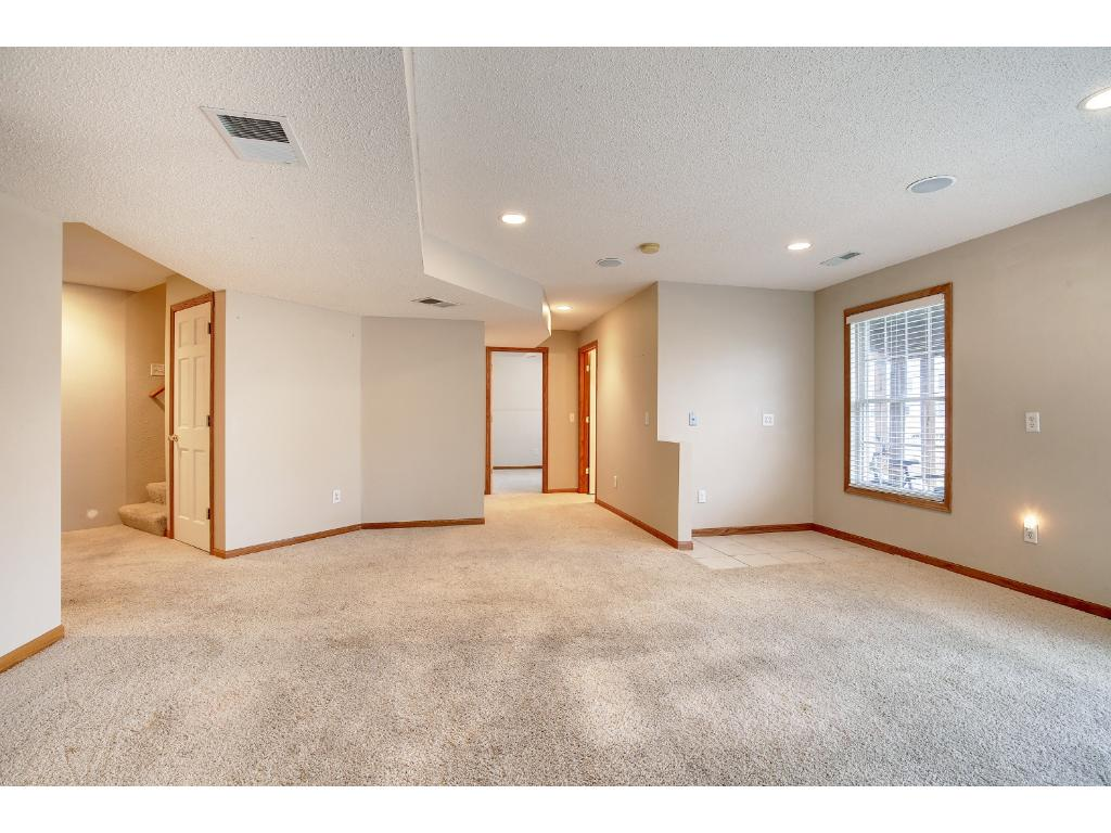 Large open floor plan in basement PLUS plumbing behind the wall near window for a sink/bar if you'd like!