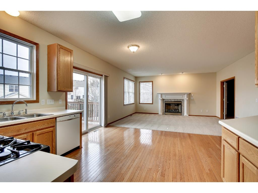 Nice open floor plan with large kitchen, eating area and family room, complete with one of the two fireplaces in the home. The office to the right is an upgrade over the standard style of this home in the neighborhood.