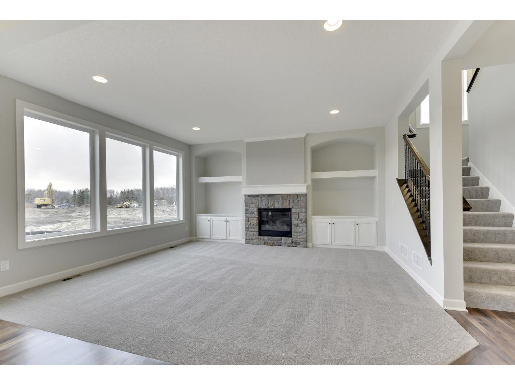 The living room on the main floor has a beautiful gas fireplace and wall built-ins.