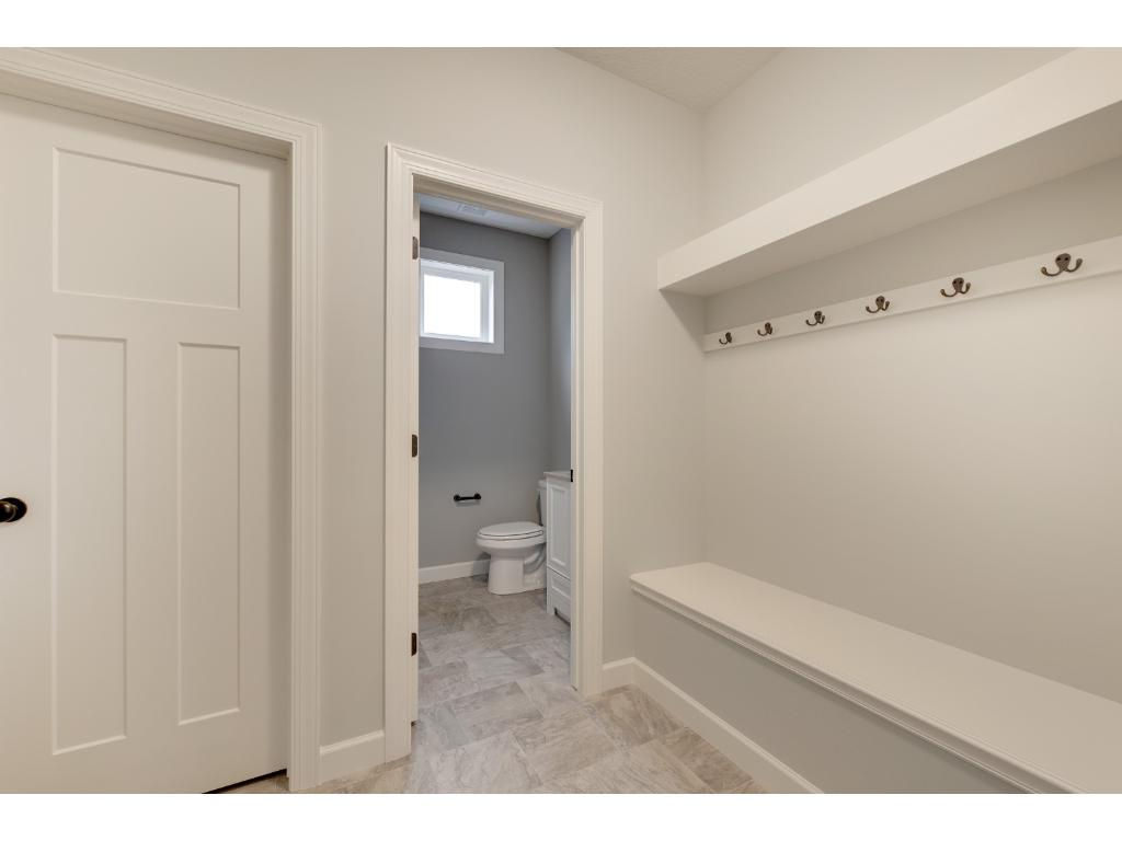The spacious mud room helps your home stay organized.