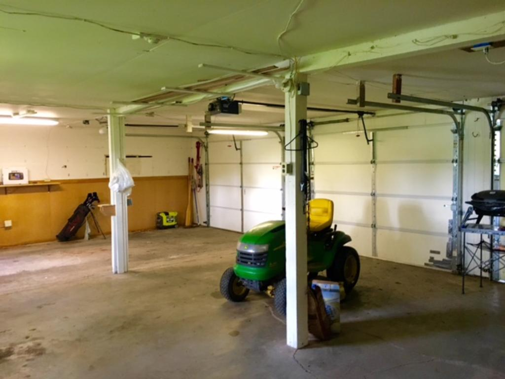 Large insulated and heated 3 car garage.
